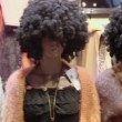 Several mannequins with dark wigs — Stock Video #60017115