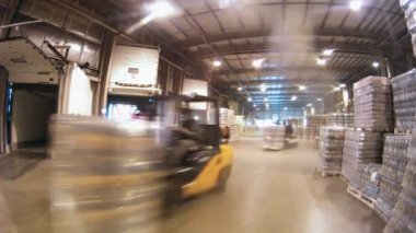 Worker puts on cart bottles — Stock Video