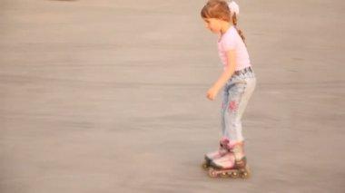 Little girl in jeans  on roller — Stock Video