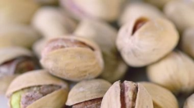 Roasted salted appetizing pistachios — Stock Video