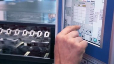 Finger pushes buttons on control unit — Stock Video