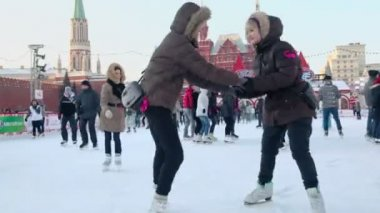 Girls in winter coats on skates — 图库视频影像