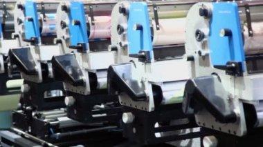 Row of machines in printing conveyor — Stock Video