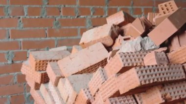 Red brick stack near wall — Stock Video