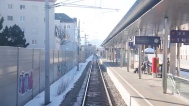 Train goes by rail near platform — Stok video