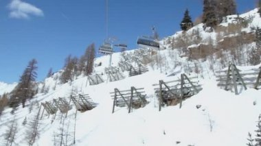 Cableway cabins ride with skiers — Stock Video