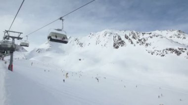 Ski chair-lift with skiers — Stock Video