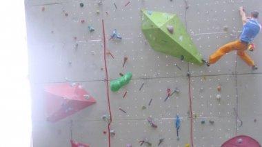 Man climbing on rock wall — Stock Video