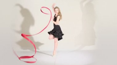 Gymnast girl dances with ribbon — Stock Video
