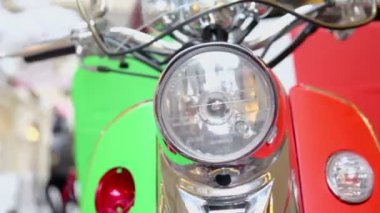 Motorbike front light on showcase — Stockvideo