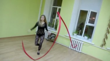 Beautiful girl dances with ribbon — Stock Video