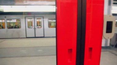 Suburban train ride near platform — Stock Video