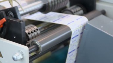Rollers spins in sticker machine — Stock Video