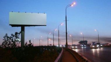 Empty advertising pillar on highway — Stock Video