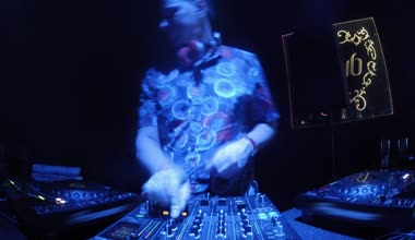 DJ mixing in club front — Stock Video