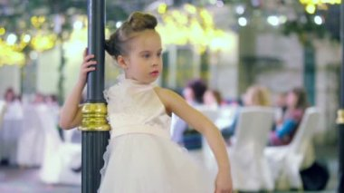 Little model shows white gown — Stock Video