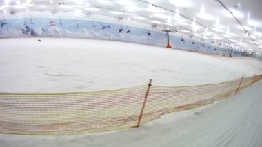 Skilift goes over snow gentle slope — Stock Video
