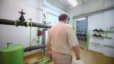 Man walks out from boiler room — Stock Video