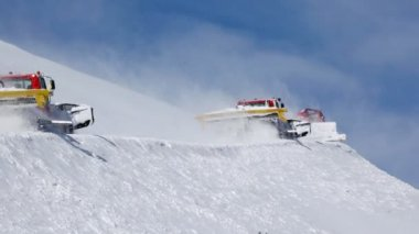 Three snowplows clean snow on mountain — Stock Video