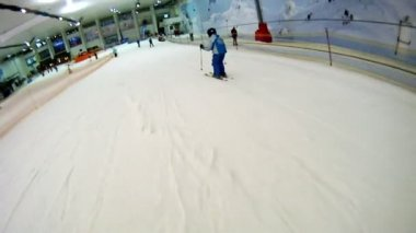 Boy goes on skis from mountain — Stockvideo