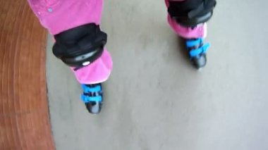 Girl rollerblading on paved road — Stock Video