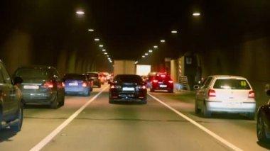 Cars make jam in dark tunnel — Stock Video