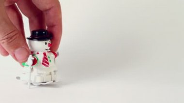 Hand wind up clockwork toy snowman — Stock Video