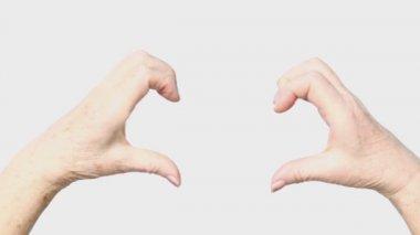 Woman senior hands show heart gesture — Stock Video