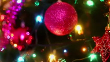 Colorful adornment with garland on fir tree — Stockvideo