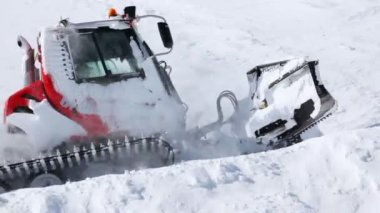Snowplow cleans snow on mountain road — Stock Video