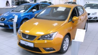Seat Ibiza stands in car shop — Stockvideo