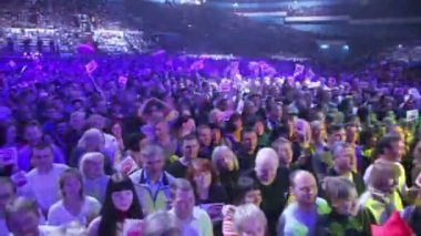 Arena with lot of fans with flags — Stock Video