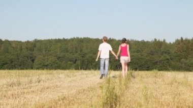 Guy holds girl's hand — Stockvideo
