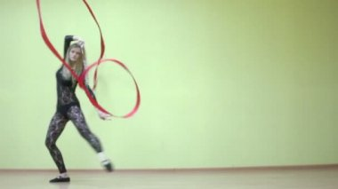 Attractive girl spins with ribbon — Stock Video