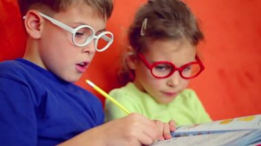 Children in glasses sit together — Stock Video