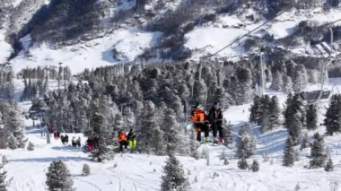 Skiers rise in chairlift — Stock Video