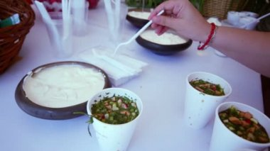 Hand adds souse cream to okroshka — Stock Video