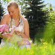 Young mother feeds her baby — Stock Video #65076663