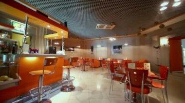 Empty cafe-bar in orange tones — Stock Video