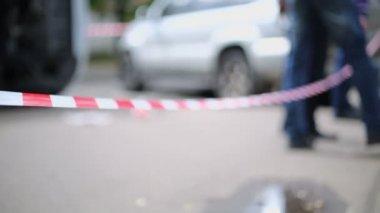 Man steps over warning ribbon — Stok video