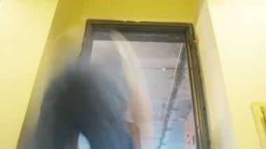 Workers cementing door — Stock Video