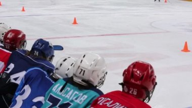 Kids in uniform watch hockey — Vídeo de Stock