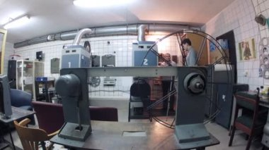 Projectionist preparing movie roller in Moscow — Stock Video