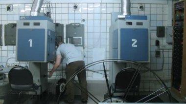 Projector operator preparing film role before movie — Stock Video