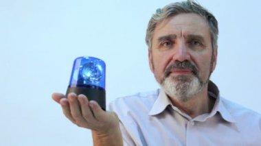 Senior man holds blue blinker — Stock Video