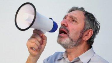 Senior man speaks in megaphone — Stock Video