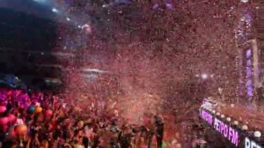 People and confetti fly during concert — Stock Video