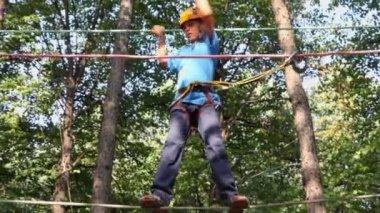 Boy in helmet walks at climbing center — Stock Video