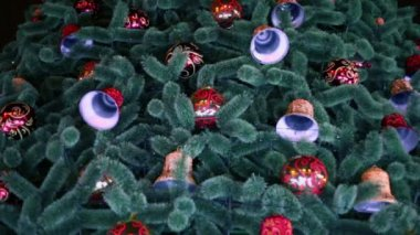 Balls and bells hangs on christmas tree — Stock Video