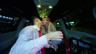 Newly couple kiss and drinks in limousine — Stock Video